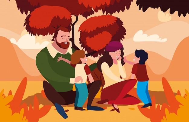 Moeder en vader met zonen in de herfst
