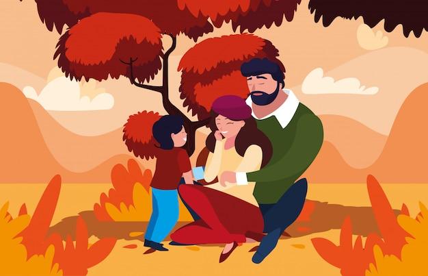 Moeder en vader met zoon in de herfst
