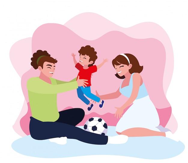 Moeder en vader met zoon spelen