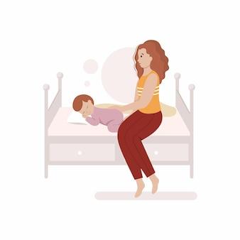 Moeder legt een pasgeboren baby naar bed. moederschap en slaap van het kind. een klein kind slaapt op het bed.