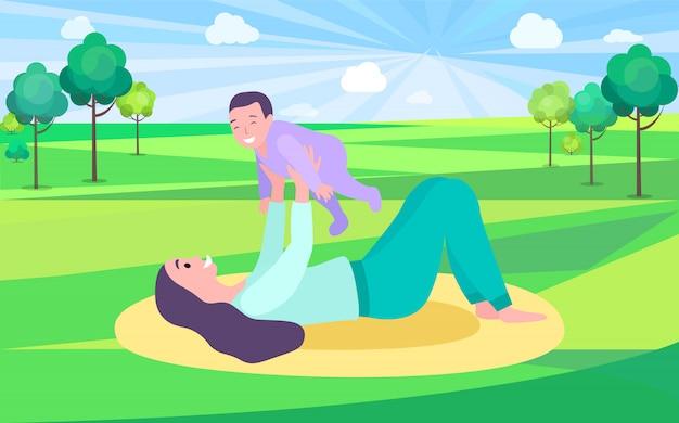 Moeder spelen met baby in park op mat