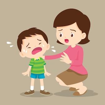 Moeder troostende huilende jongen Premium Vector