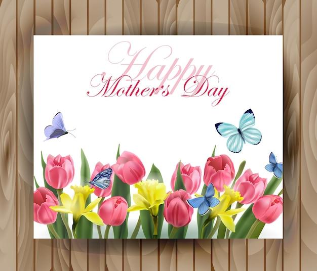 Moederdag wenskaart met bloeiende lente bloemen roze tulpen narcissen en vlinders