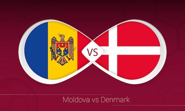Moldavië vs denemarken in voetbalcompetitie, groep f. versus pictogram op voetbal achtergrond.