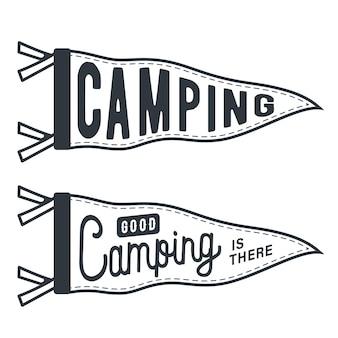 Monochroom silhouet vlagaanwijzer met de inscriptie camping
