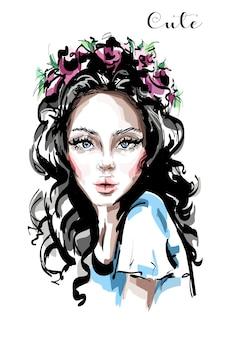 Mooi meisje in bloemenkrans