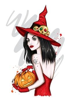 Mooi meisje in een heksenkostuum. vrouw met een pompoen.