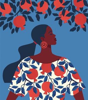Mooi meisje in een jurk met granaatappelpatroonprint en granaatboom.