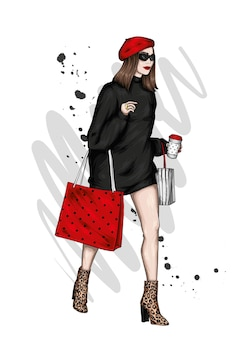 Mooi meisje in stijlvolle kleding en boodschappentassen
