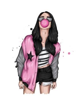 Mooi meisje in stijlvolle kleding en kauwgom