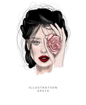 Mooi meisje met een rosebud dichtbij haar gezicht