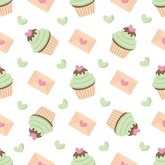 Mooi naadloos patroon met cupcakes en harten voor valentijnskaartdag.