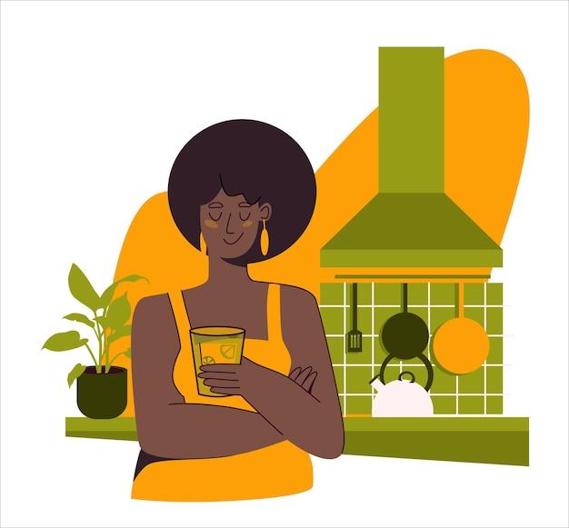 Mooie afro-amerikaanse vrouw staat in de keuken met een glas ijsthee platte vectorillustratie