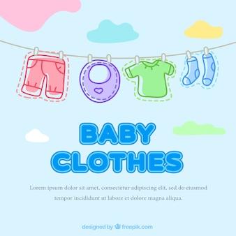 Mooie baby kleding opknoping aan een touw achtergrond