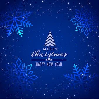 Mooie blauwe sneeuwvlokkenachtergrond voor vrolijke kerstmis