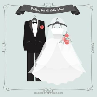 Mooie bruiloft pak en bruid jurk