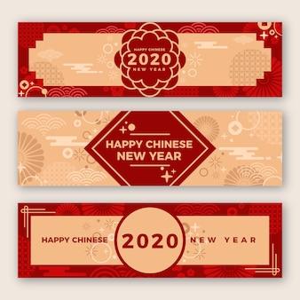 Mooie chinese nieuwjaarbanners in plat ontwerp