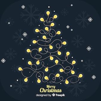 Mooie donkere kerstmisachtergrond met gloeilampenboom