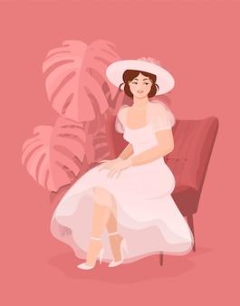 Mooie gelukkige bruid in witte jurk, handschoenen en een hoed zittend op een stoel