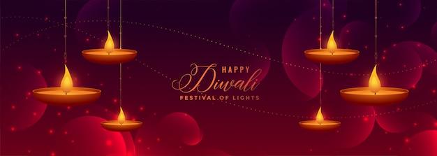 Mooie gelukkige diwali glanzende banner met hangende diya