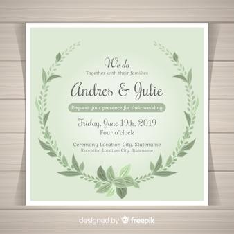 Mooie huwelijksuitnodiging met hand getrokken bladeren