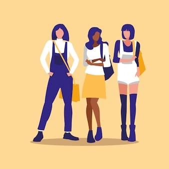 Mooie interraciale meisjesgroepsmodellering met handtas