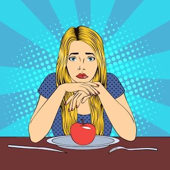 Mooie jonge blonde vrouw in dieet met appel op een plaat. pop art.