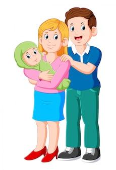 Mooie jonge ouders en schattige baby