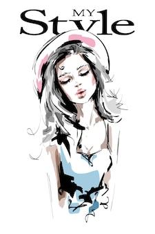 Mooie jonge vrouw in hoed op wit wordt geïsoleerd