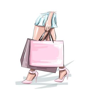 Mooie jonge vrouw met boodschappentassen mode vrouw in blauwe rok vrouwen op straat
