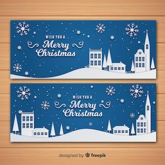 Mooie kerststad banners in papieren stijl