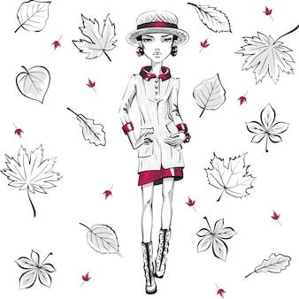 Mooie mode hipster meisje topmodellen in herfstkleren, hoed en laarzen, jas en rok