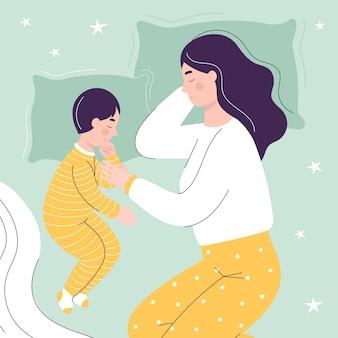 Mooie moeder en zoon slapen in bed