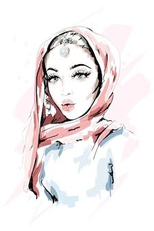 Mooie moslimvrouw die hijab draagt