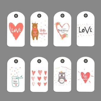 Mooie set van 8 valentijnsdag cadeaukaart, label, tag, badge met hart, teddybeer en belettering liefde. hand getrokken ontwerpelementen voor print, poster, uitnodiging, feestdecoratie. vector.
