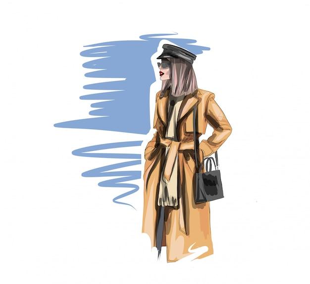 Mooie vrouw in een beige regenjas. mooi meisje van modelverschijning. mode en stijl.