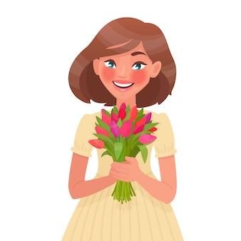 Mooie vrouw met een boeket bloemen