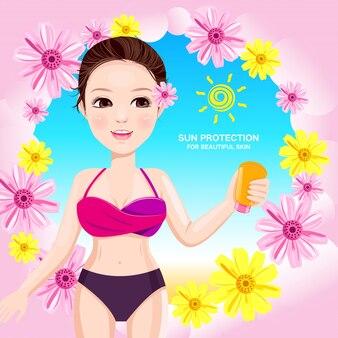 Mooie vrouw met zonlichaambescherming