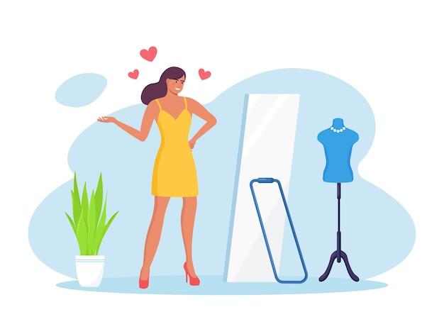 Mooie vrouw permanent, spiegel kijken en glimlachen. zelfliefde, zelfacceptatie, zelfvertrouwen. hou van jezelf. vrouwelijk narcisme