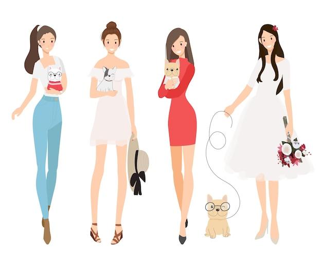 Mooie vrouwen die de tekencollectie van het franse buldogpuppy houden
