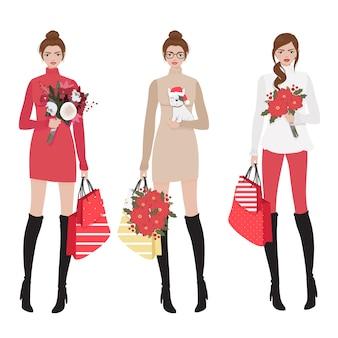 Mooie vrouwen in rode winter kerstkostuum winkelen collectie