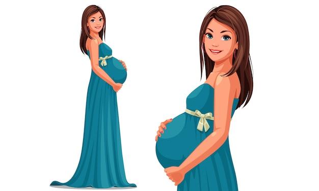 Mooie zwangere vrouw die lange blauwe kleding draagt die haar buik houdt
