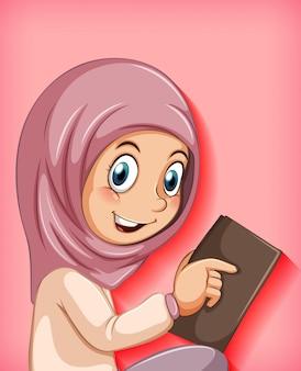 Moslim meisje dat het boek leest