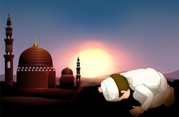 Moslim persoon die bij moskee bidt
