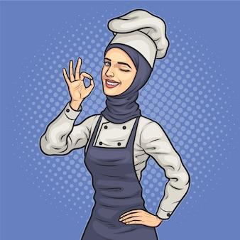 Moslim vrouwelijke chef-kok in hijab