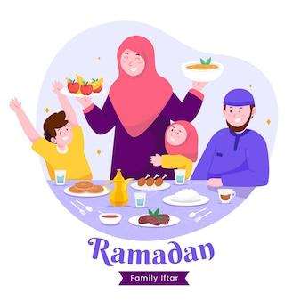 Moslimfamilie iftar die samen in geluk geniet van ramadan tijdens het vasten