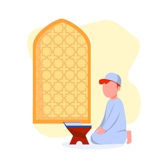 Moslimjong geitje die koranillustratie reciteren