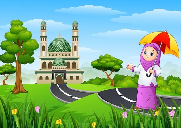 Moslimmeisjesbeeldverhaal in de straat aan moskee