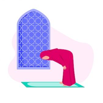 Moslimvrouw die shalat beoefent