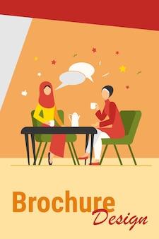 Moslimvrouwen ontmoeten elkaar in arabische coffeeshop. vriendinnen dragen hijab drinken koffie platte vectorillustratie. vriendschap, communicatieconcept voor banner, websiteontwerp of bestemmingswebpagina
